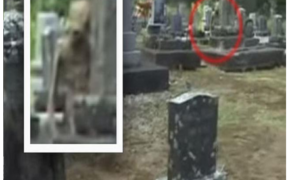 Grey Alien Caught on Camera Behind Cemetery Tombstone